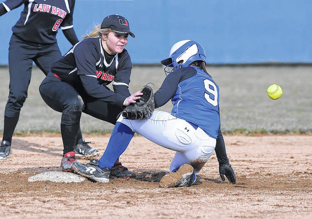 Allen East's Summer McCloskey steals second base while Upper Scioto Valley's Haley Hunsicker waits for the throw during Monday's softball game at Allen East High School in Harrod.