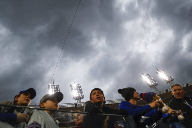 Storm clouds gather overhead Tuesday night in Cincinnati before game between the Reds and Chicago Cubs. The game was later postponed.