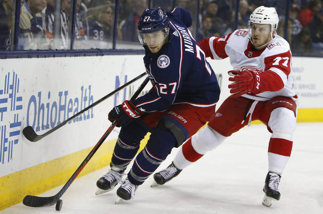 Columbus Blue Jackets' Mark Letestu, right, starts a breakaway as Detroit Red Wings' Gustav Nyquist, of Sweden, defends during the second period of an NHL hockey game Tuesday, April 3, 2018, in Columbus, Ohio.