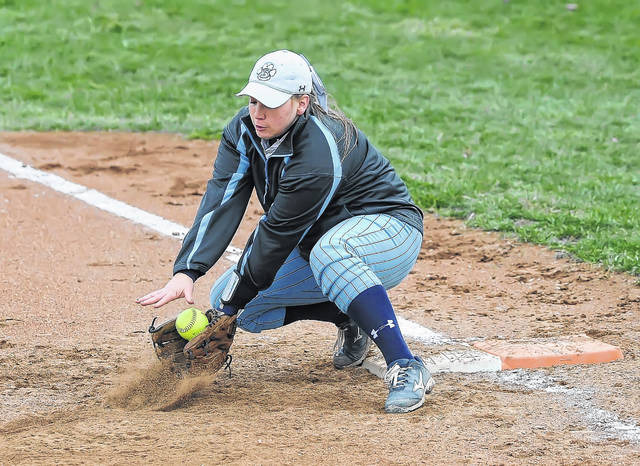 Bath's Kennedi Sullivan scoops up a throw at first base during Thursday's game against Napoleon at Bath High School. See more game photos at LimaScores.com.