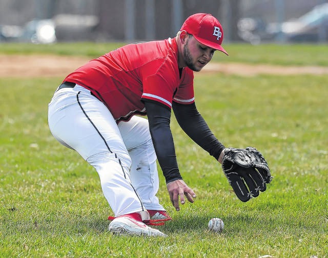 Bluffton's Aaron Belcher fields a ground ball during Saturday's game against Liberty-Benton in Bluffton. See more game photos at LimaScores.com.