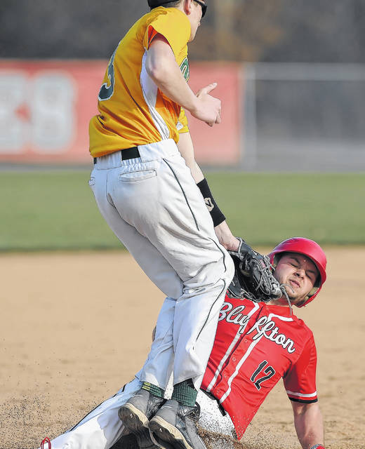 Bluffton's Aaron Belcher steals third base before the tag of Ottoville's Dylan Kemper during Wednesday's game in Bluffton.