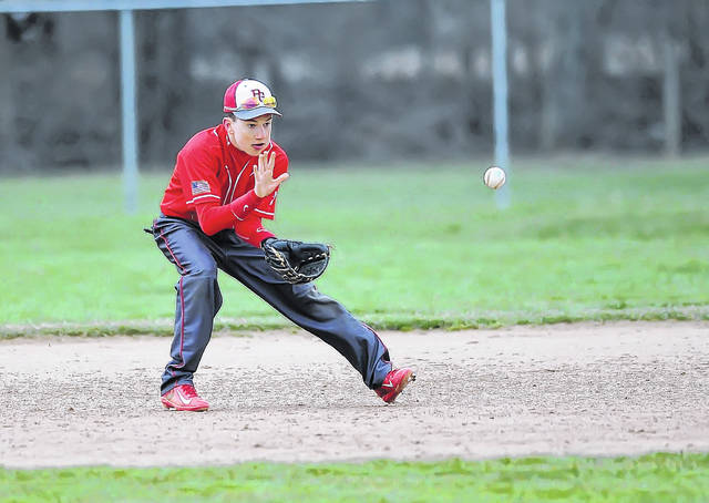 Pandora-Gilboa's Trey Hovest fields a ball during Tuesday's game at Columbus Grove.
