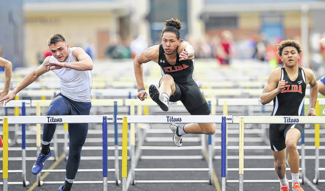 Elida's Xavier Gilkeym center, competes in the 110 hurdles during Friday's Gold Medal Track and Field Invitational in Ottawa.