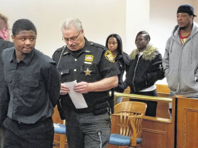 Jayleontre Harris, left, looks back to family and friends supporting him Monday in Allen County Common Pleas Court. Harris received a 14-year prison sentence for aggravated robbery connected to the 2016 shooting death of Eric Staup.