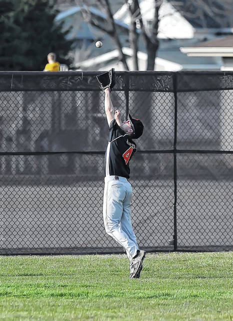 Fort Jennings' Aaron Sealts gets under a fly ball during Thursday's game at Holy Name Ballpark in Kalida.