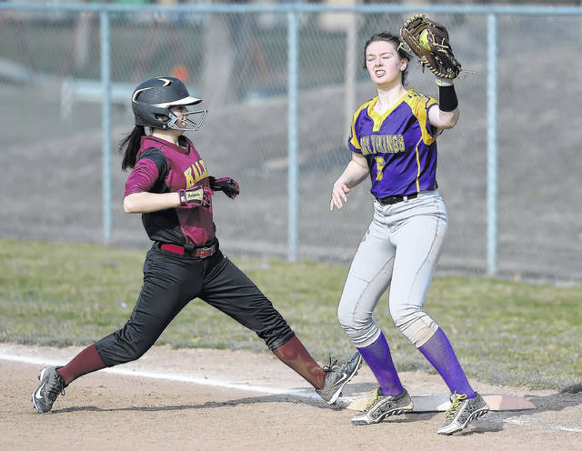 Kalida's Melanie Meyers steps on the base before Leipsic's Bailee Sickmiller can make the tag during Thursday's game at Kalida High School.
