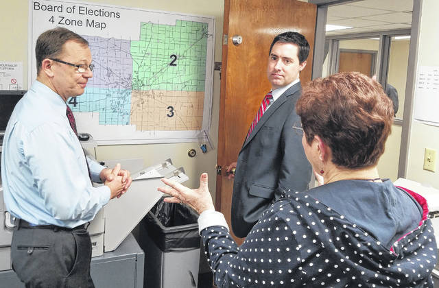 State Sen. Frank LaRose, middle, listens as Allen County Board of Elections Director Kathy Meyer, right, and Deputy Director Mark Vernik talk about polling locations in the county. LaRose is the Republican candidate for Ohio Secretary of State, which oversees the state's elections.