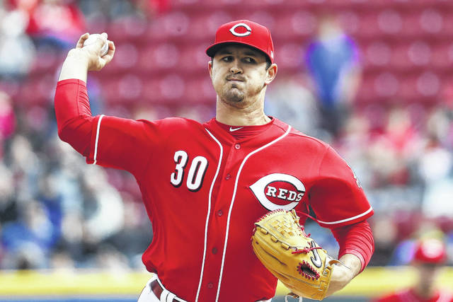 Cincinnati Reds starting pitcher Tyler Mahle throws in the first inning of a baseball game against the Chicago Cubs on Monday. His six shutout innings helped the Reds to a 1-0 win.