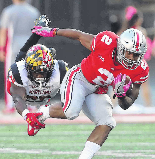 Ohio State running back J.K. Dobbins (2) rushed for more than 1,400 yards last season as a freshman and looks to build on those numbers this year.