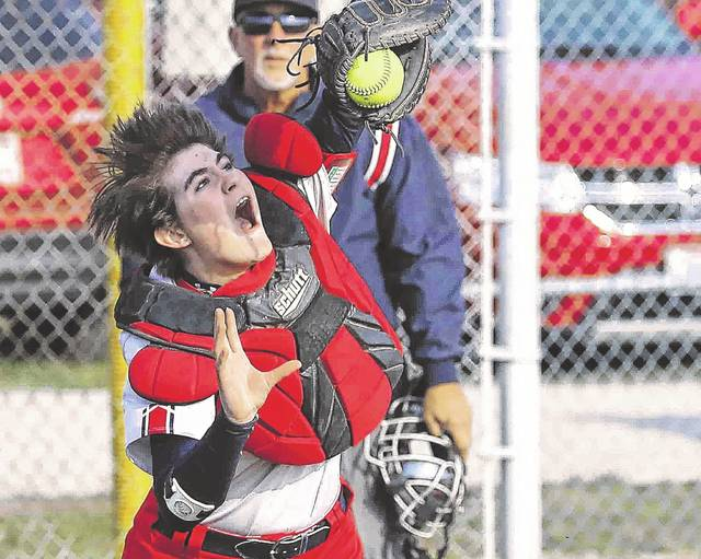 Perry 's Destiny Money makes the catch on foul ball in the top of the second inning against Delphos Jefferson at Perry High School Wednesday.