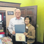 Two realtors with CCR Realtors presented with certificate