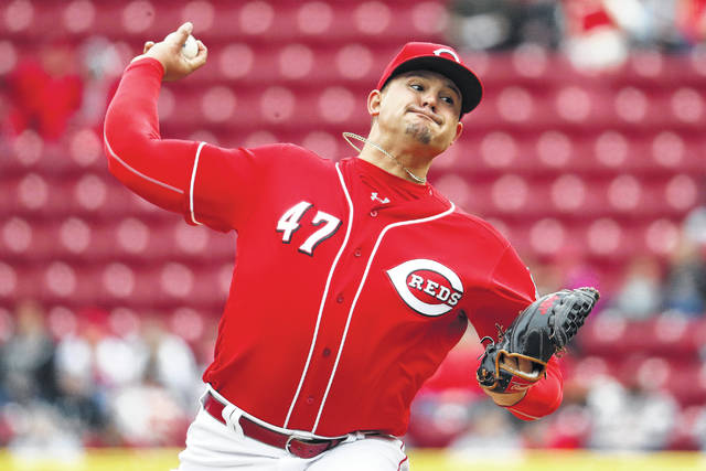 Cincinnati Reds starting pitcher Sal Romano throws in the first inning of a baseball game against the Washington Nationals Sunday.