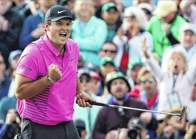 Patrick Reed reacts after winning the Masters golf tournament on the 18th hole on Sunday in Augusta, Ga. It was his first major championship.