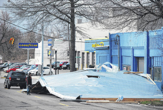 J Swygart | The Lima News  Gusting winds ripped the roof off a downtown building Wednesday morning, depositing the roof nearly intact in the middle of North Pierce Street, near the intersection of Market Street. A man who said he was the owner of the building at 111 N. Pierce St. that formerly housed Power Block Motors said the incident happened around 8 a.m.