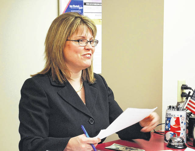 Allen County Assistant Prosecutor Terri Kohlrieser files nominating petitions with the county board of elections as a candidate for judge of the Court of Common Pleas in this file photo.