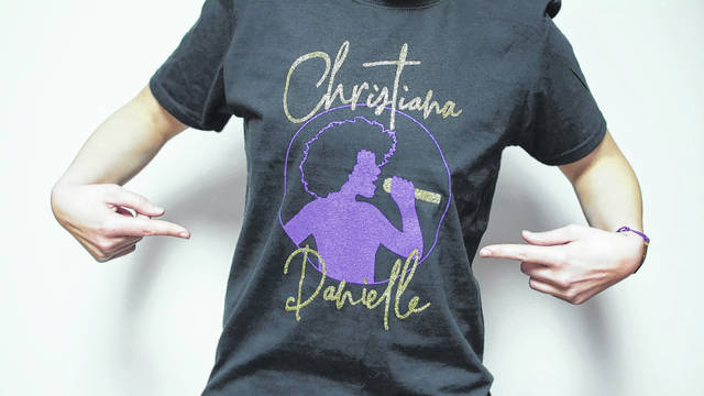 """Photo provided Elida native Kayla Lane designed this T-shirt for Christiana Danielle, a contestant on """"The Voice."""""""