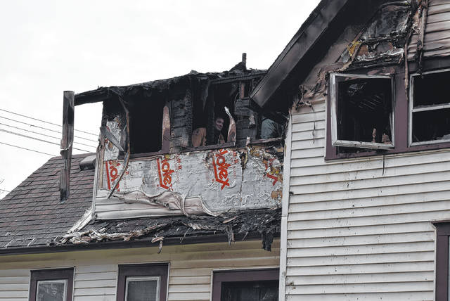 Fire investigators look for the cause of a fire that killed two people in Van Wert on Friday morning.
