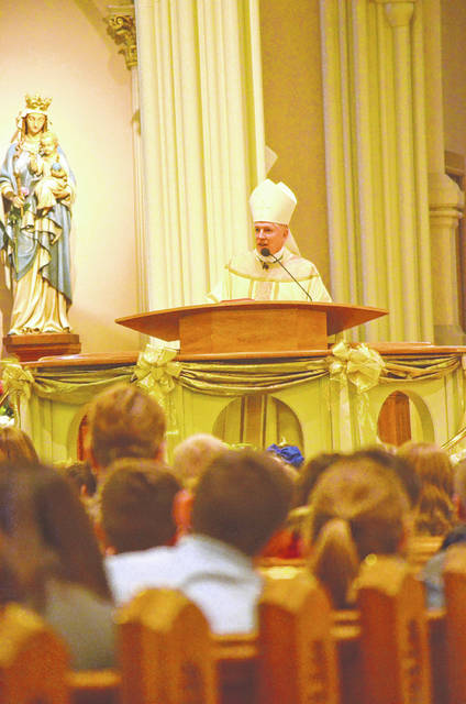 Bishop Daniel Thomas leads a special all-school mass at Delphos St. John's school Friday. After the mass, Thomas held a question and answer session with junior and senior students in the auxiliary gymnasium at the school.