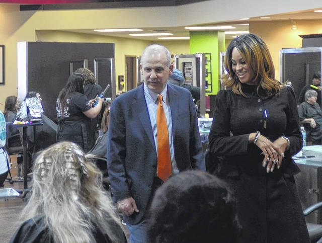 State Senator Matt Huffman interacts with people at Ohio State Beauty Academy to understand the training offered there and other similar places.