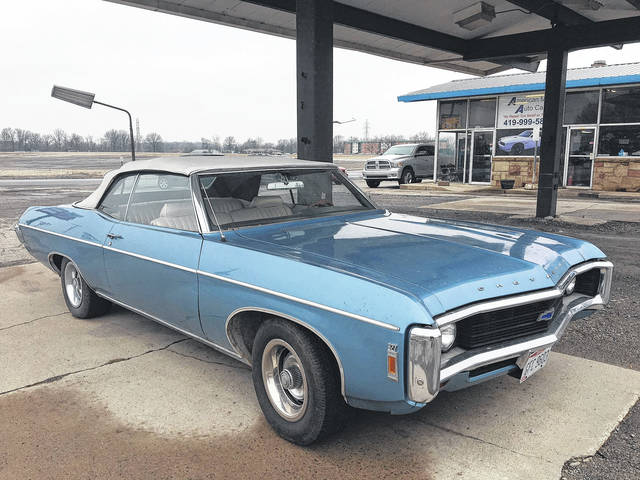 John Waller owns this 1969 Chevy Impala Convertible. His uncle had owned it at one time.