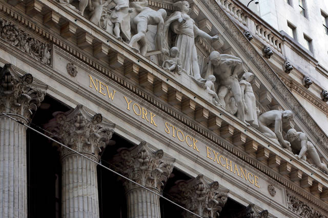 FILE- This April 5, 2018, file photo shows the facade of the New York Stock Exchange. The U.S. stock market opens at 9:30 a.m. EDT on Tuesday, May 1, 2018.  (AP Photo/Richard Drew, File)