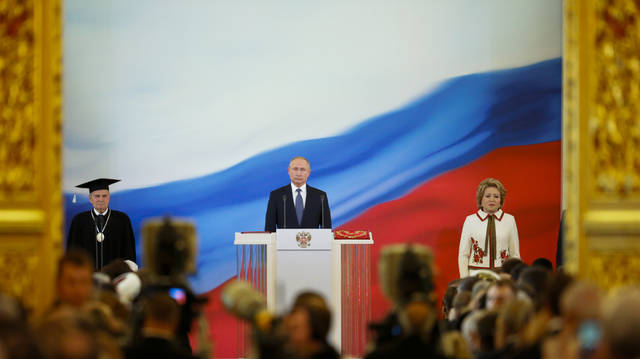Vladimir Putin, center, speaks during his inauguration ceremony for a new term as Russia's president, with Constitutional Court Chairman Valery Zorkin, left, and Valentina Matviyenko, speaker of the Federation Council, Russian parliament's upper chamber, right, next to him in the Grand Kremlin Palace in Moscow, Russia, Monday, May 7, 2018. Putin took the oath of office for his fourth term as Russian president on Monday and promised to pursue an economic agenda that would boost living standards across the country. (AP Photo/Alexander Zemlianichenko, Pool)