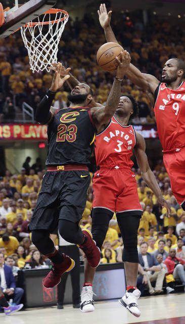 Cleveland Cavaliers' LeBron James (23) goes up to shoot against Toronto Raptors' Serge Ibaka (9), from Republic of Congo, and OG Anunoby (3) in the first half of Game 4 of an NBA basketball second-round playoff series, Monday, May 7, 2018, in Cleveland.