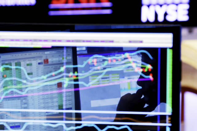 FILE - In this Jan. 11, 2016, file photo, specialist Anthony Rinaldi is silhouetted on a screen at his post on the floor of the New York Stock Exchange. The U.S. stock market opens at 9:30 a.m. EDT on Monday, May 14, 2018. (AP Photo/Richard Drew, File)