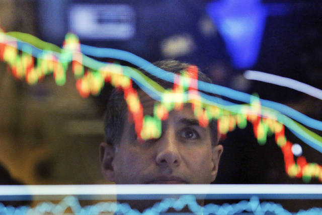 FILE- In this April 19, 2017, file photo, specialist Anthony Rinaldi is reflected in a screen at his post on the floor of the New York Stock Exchange. The U.S. stock market opens at 9:30 a.m. EDT on Tuesday, May 15, 2018. (AP Photo/Richard Drew, File)