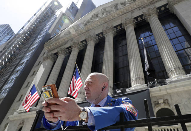 FILE- In this April 26, 2018, file photo, Vincent Pepe enjoys some fresh air outside the New York Stock Exchange where he works in the Financial District in New York. The U.S. stock market opens at 9:30 a.m. EDT on Wednesday, May 16. (AP Photo/Kathy Willens, File)