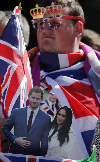 A royal fan waits to watch a rehearsal of the royal wedding in Windsor, England, on Thursday. Preparations are being made in the town ahead of the wedding of Britain's Prince Harry and Meghan Markle that will take place in Windsor on Saturday.
