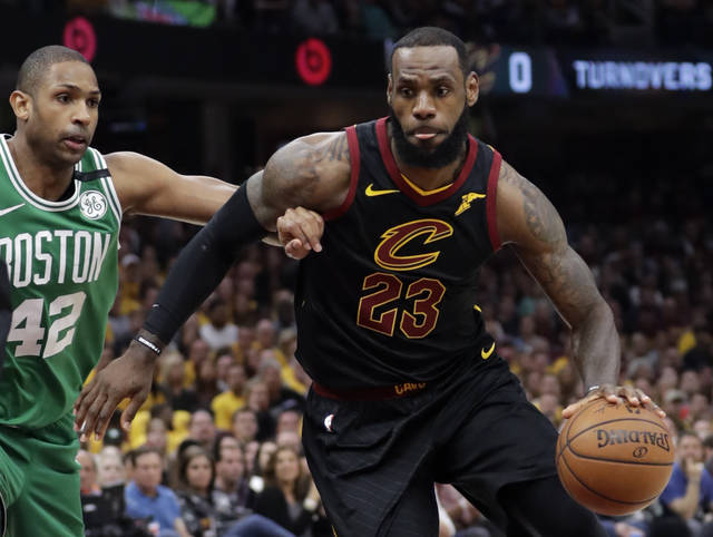 Cleveland Cavaliers' LeBron James (23) drives past Boston Celtics' Al Horford (42), from Dominican Republic, in the first half of Game 4 of the NBA basketball Eastern Conference finals, Monday in Cleveland.