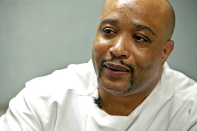 FILE - This July 14, 2010, file photo, shows Kevin Keith, who is on death row at the Ohio State Penitentiary in Youngstown, Ohio. Keith, an Ohio inmate who has long maintained his innocence in the 1994 slaying of three people is asking the U.S. Supreme Court for a new trial based on evidence never heard by a jury. Lawyers for Keith say the personnel file of a state forensics investigator who worked on his case contains allegations she had a habit of providing police departments answers they wanted in cases. (Shari Lewis/The Columbus Dispatch via AP)