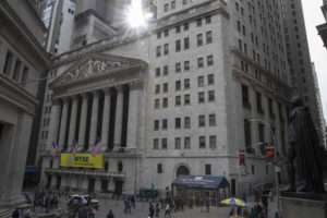 Fed gives stocks a boost; technology and retailers rally