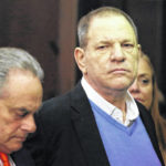 Handcuffed Weinstein faces rape charge