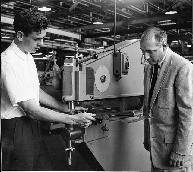"This photo published in the Lima Citizen in September 1958 shows James Cramer, left, and W.V. Trask of Lennox Tool & Machine Builders, 651 N. Baxter St. ""They left this morning for Los Angeles to attend a tool show being held in conjunction with the semi-annual meeting of the American Society of Tool Engineers. The Lennox-built MetlMastr they are examining will be on display at the show. A sheet-metal working machine, the MetlMastr is the only machine of its type built in the U.S., according to Trask, who is sales manager for Lennox Tool."""