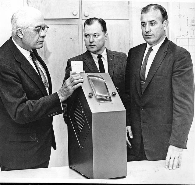 This photo, published in The Lima News on Dec. 15, 1069, shows County Commissioners Roy Roush, Owen Mason and Harold Kiracofe looking over the new Coyle voting machine which the county put in use in May. Allen County was the first area in the nation to use the machine, manufactured in Lima on a full-scale basis. California counties were considering the machine.