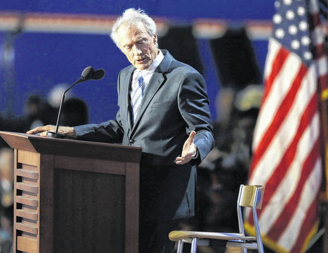 FILE - In this Aug. 30, 2012 file photo, actor and director Clint Eastwood speaks to an empty chair while addressing delegates during the Republican National Convention in Tampa, Fla. On Friday, May 11, 2018, The Associated Press has found that stories circulating on the internet that Eastwood donated a ranch and other assets to President Donald Trump's 2020 re-election are untrue.