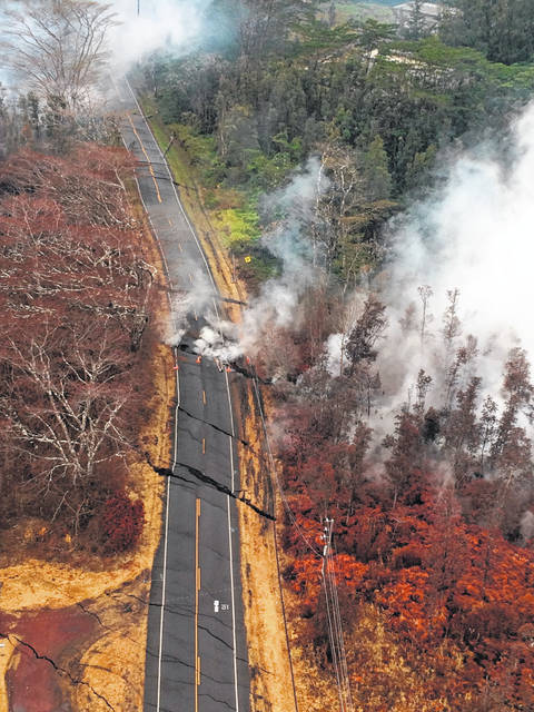 This Thursday, May 17, 2018, aerial image released by the U.S. Geological Survey, shows a view of ground cracks on Pohoiki Road during an overflight of the eruptive fissure area at about 7 a.m. HST near Pahoa, Hawaii. Cracks continued to open and widen, some with horizontal and vertical offsets, in the area during the past 24 hours. These cracks are caused by the underlying intrusion of magma into the lower East Rift Zone in the Big Island of Hawaii.