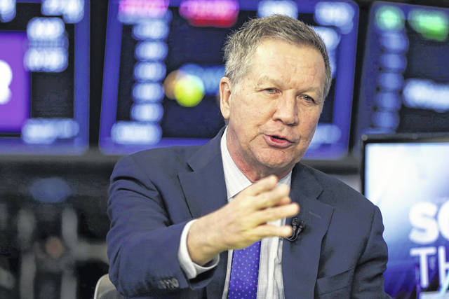 FILE - In a March 14, 2018 file photo, Ohio Gov. John Kasich is interviewed on the floor of the New York Stock Exchange. Kasich delivered the spring graduation address at the Harvard Kennedy School in Cambridge, Massachusetts on Wednesday.