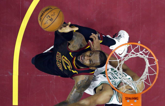 Cleveland Cavaliers' LeBron James, left, reaches for the ball over Boston Celtics' Al Horford during the second half of Game 6 of the NBA basketball Eastern Conference finals Friday, May 25, 2018, in Cleveland. The Cavaliers won 109-99. (AP Photo/Tony Dejak)