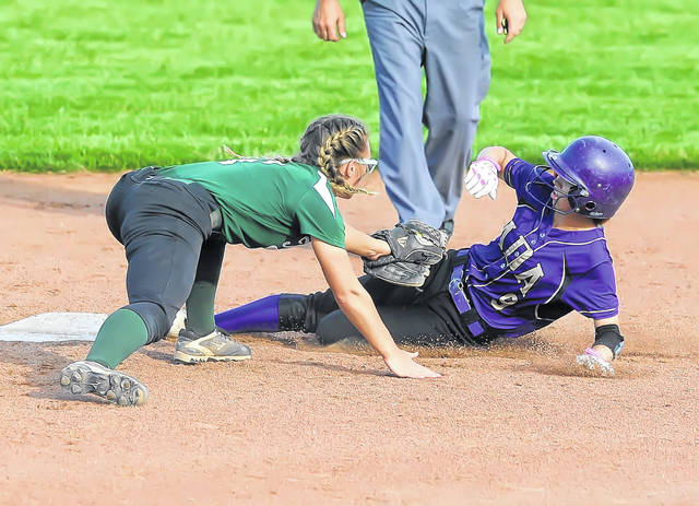 Ada's Alexis Ennis safely reaches second base on a steal against Tinora's Quinn Slattman during a Wednesday Division IV regional semifinal in Findlay. See more game photos at LimaScores.com.