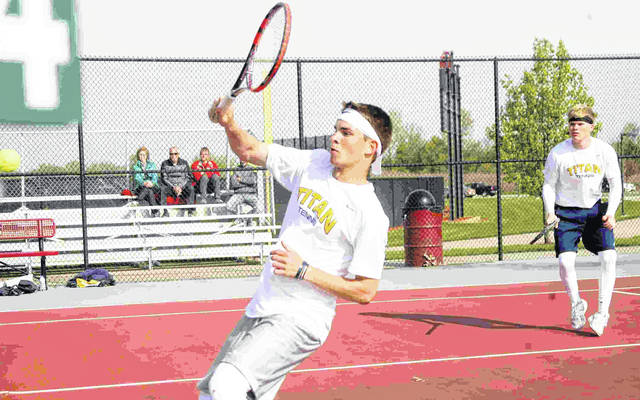 Otttawa-Glandorf's Zach Balbaugh returns a shot Saturday as partner Drew Kuhlman looks on during doubles action at the Division II sectional at the University of Northwestern Ohio. Jose Nogueras | The Lima News