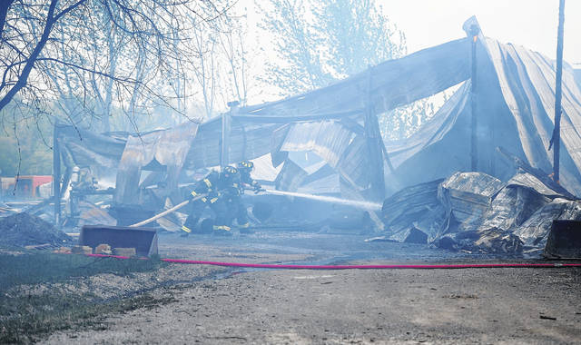 Spencerville and Delphos Firefighters respond to a barn fire at 14455 West Union Road in Spencerville on Wednesday afternoon. The fire is under investigation.