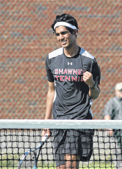 Shawnee's Harsha Battula, playing in the No. 1 doubles with Carter Schaff, celebrates a winner against St. Marys Tuesday. Jose Nogueras | The Lima News