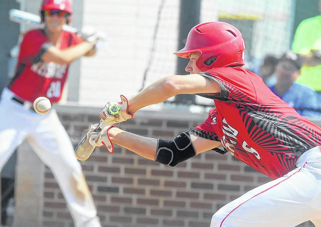 Wapakoneta's Joel Roediger lays down a bunt against Ontario during Sunday's Division II regional final game at Carter Park in Bowling Green.  Richard Parrish | The Lima News