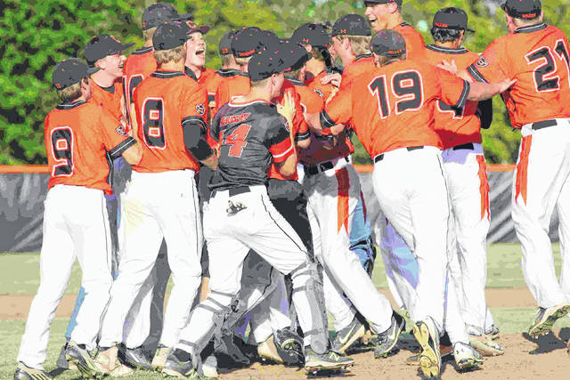 Coldwater celebrates defeating Columbus Academy, 7-2, in Friday's Division III regional final at Elida.