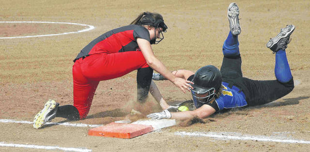 Columbus Grove first baseman Angel Schneider tags out Lincolnview's Lakin Brant on a pick off play during a Division IV district semifinal Wednesday at Elida.