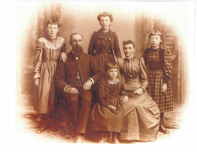 The John Harruf family. Their home was above their business, and they lost both in the fire.